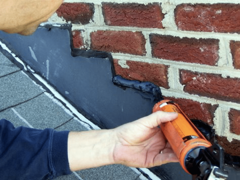 EXTERIOR CAULKING being applied by a contractor