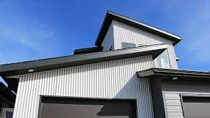 Metal siding installation on a new build