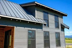 Metal siding installation on a new home