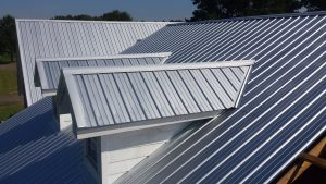 Metal roof installation on a new build
